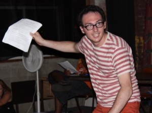 Black Kat actor, Erik Larson rehearsing a scene from 2015 In Review: A Living Newspaper.