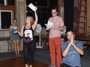 (L to R) Jennifer Diamond Umberger, Casey Adelman, Erik Larson & Louis Quinn, rehearsing a scene from 2015 In Review: A Living Newspaper